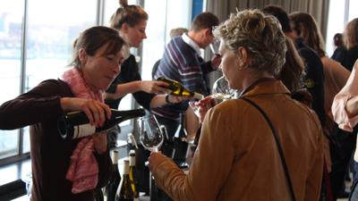 Coralie Delecheneau pouring her wine