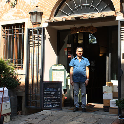 Francesco Tognoni in front of his Enoteca Tognoni in Bolgheri